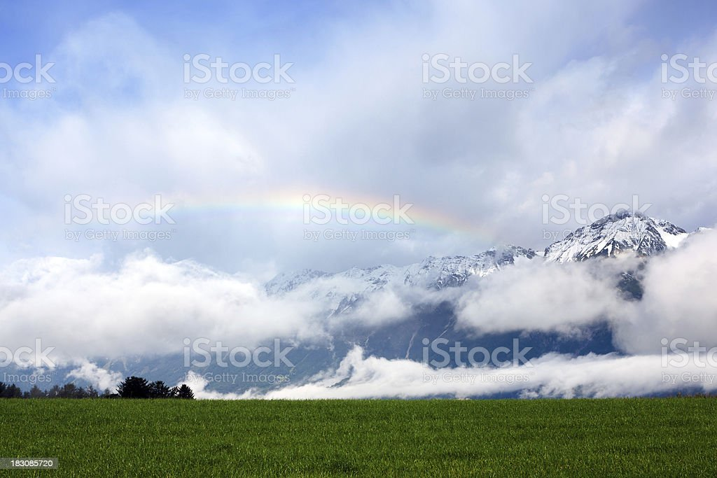 Rainbow in the Alps royalty-free stock photo