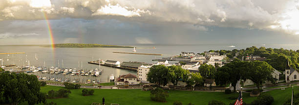 rainbow in the harbor - mackinac island stock photos and pictures