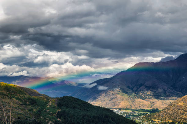 Rainbow in the mountains of Queenstown, New Zealand stock photo