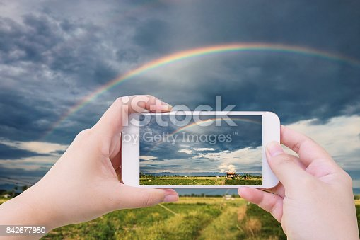 istock rainbow in the sky over agriculture field 842677980