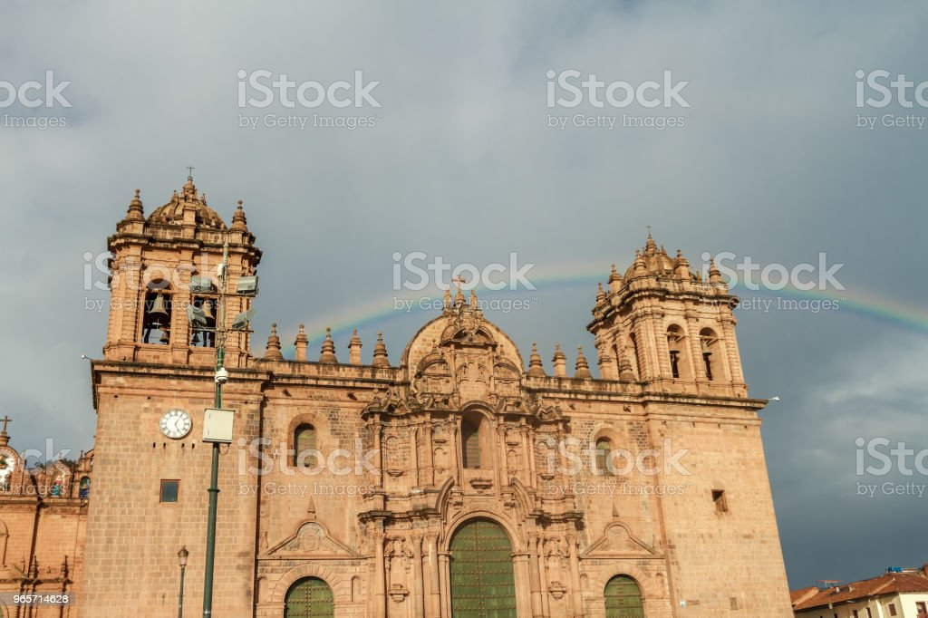 Rainbow is formed over the cathedral of Cusco (Peru) - Royalty-free Ancient Stock Photo