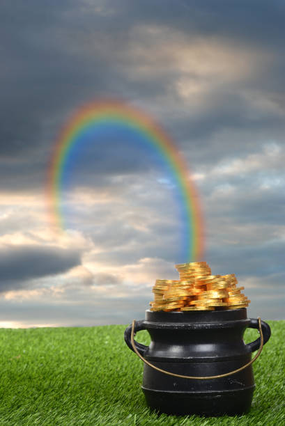 rainbow leading to pot of gold - luck of the irish stock photos and pictures