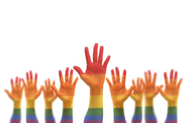 Rainbow multi-color flag pattern on blur many people human hands raising upward isolated on white background (clipping path) Rainbow multi-color flag pattern on blur many people human hands raising upward isolated on white background (clipping path) lgbtqi rights stock pictures, royalty-free photos & images