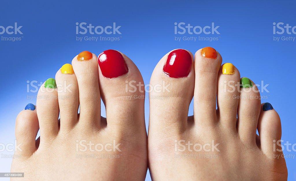 Rainbow nail polish feet art stock photo