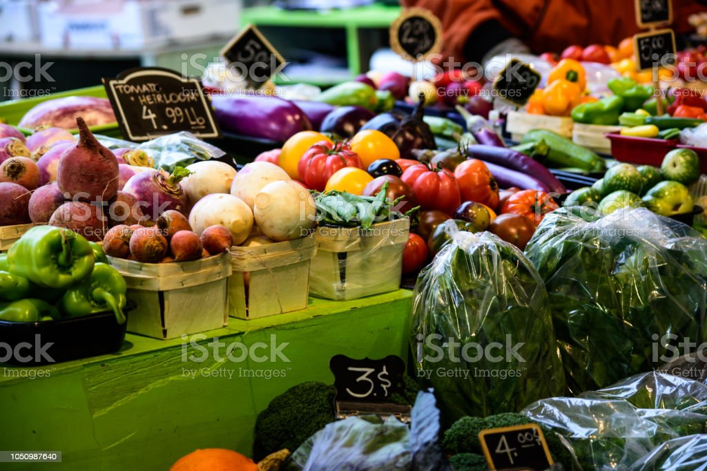 Rainbow of color in fresh healthy vegetables  on table at farmers market organic healthy food stock photo
