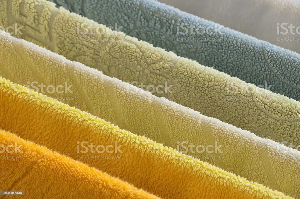 Rainbow of colored towels stock photo