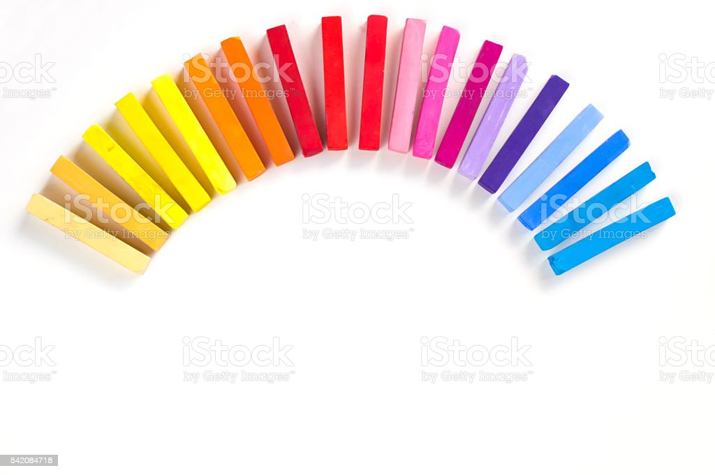 Rainbow of colorful chalks and pastels stock photo