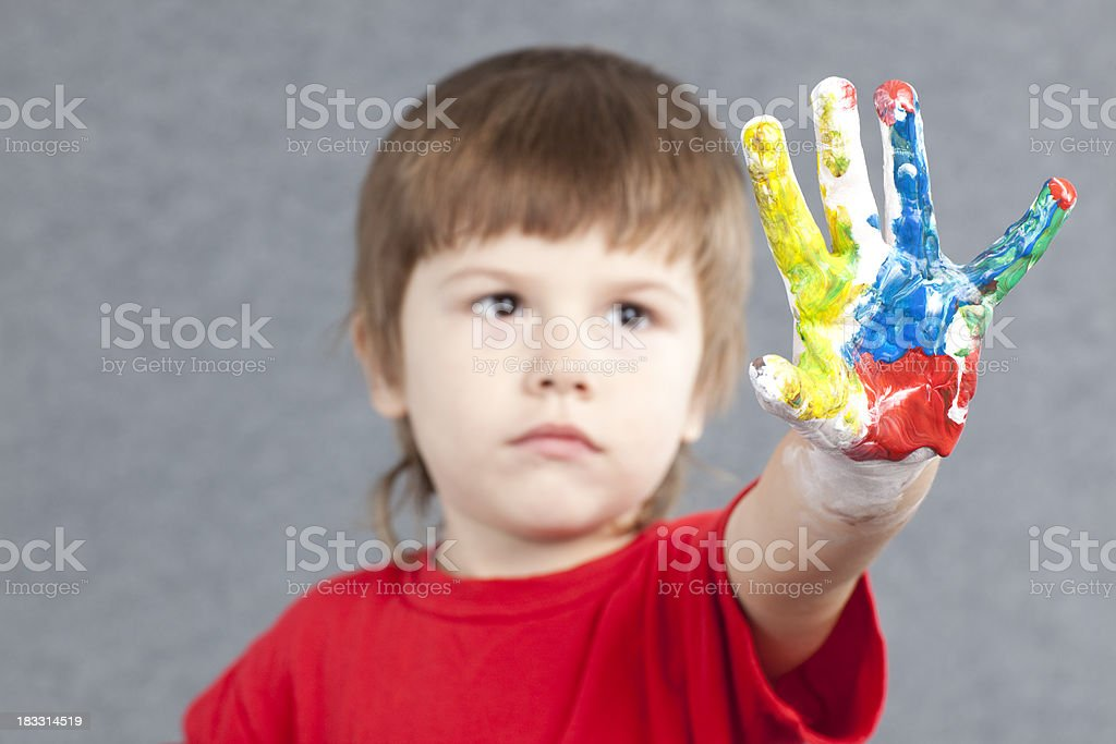 Rainbow of colors on a kid's arm. stock photo