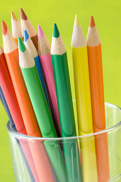 Rainbow of colors Color pencils in a glass cup artistical stock pictures, royalty-free photos & images