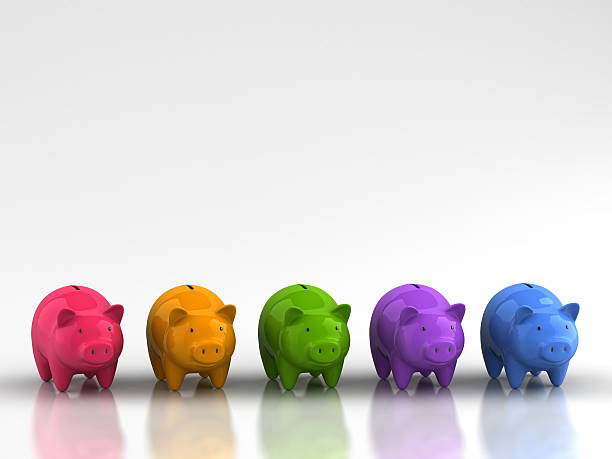 Rainbow of piggy banks representing savings growth stock photo
