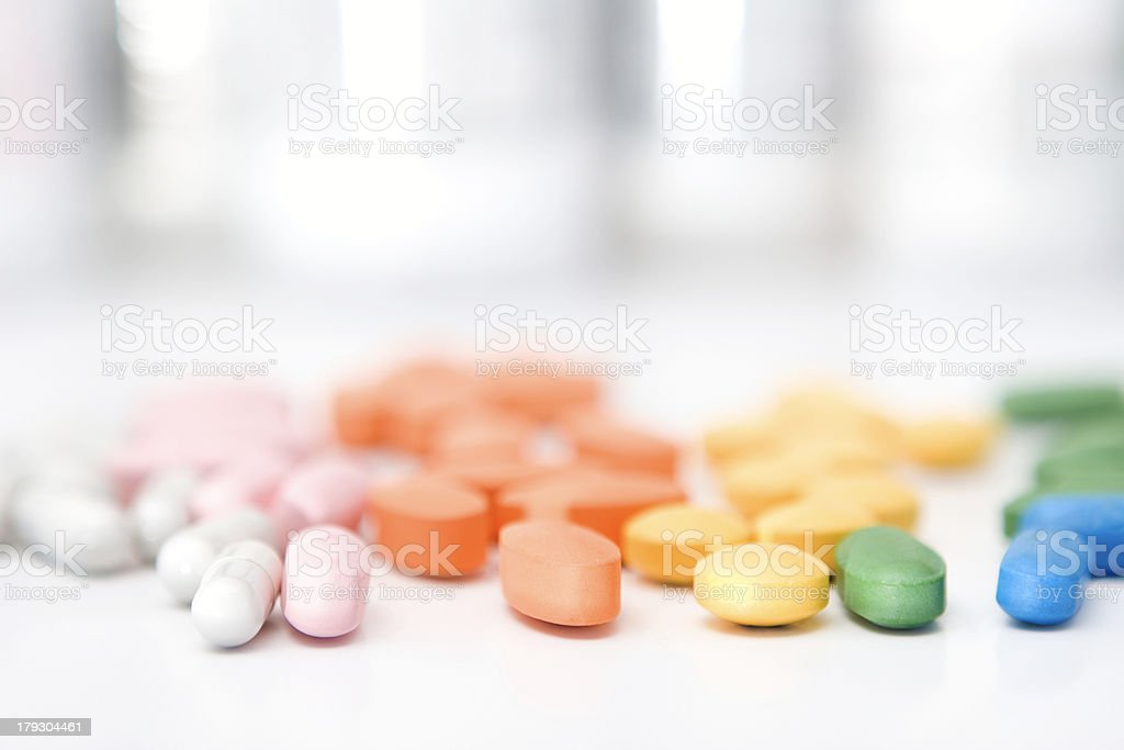 rainbow of pills stock photo