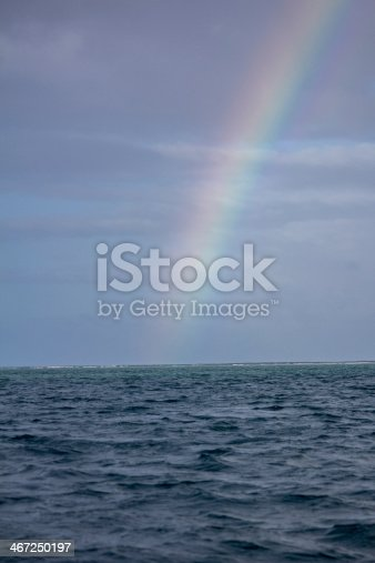 During a rain shower a rainbow appears over the sea in Store Bay Tobago.