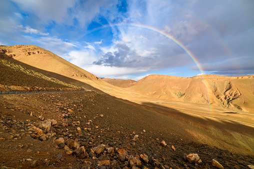 istock Rainbow on a mountain road in High Atlas, Morocco 486836258