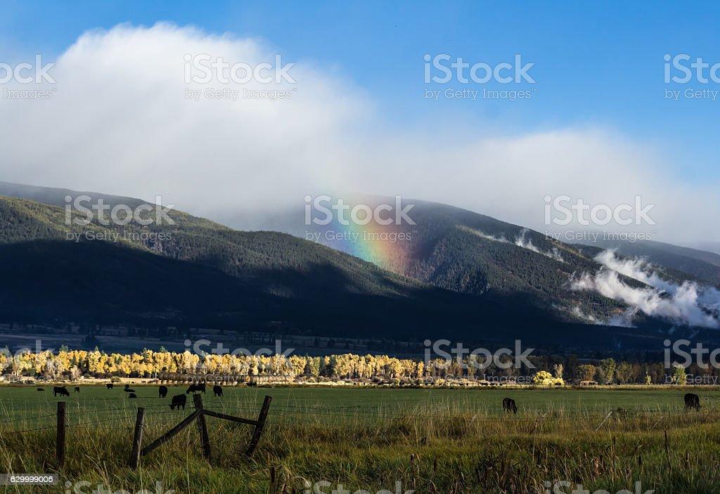 Rainbow on Bitterroot Range stock photo