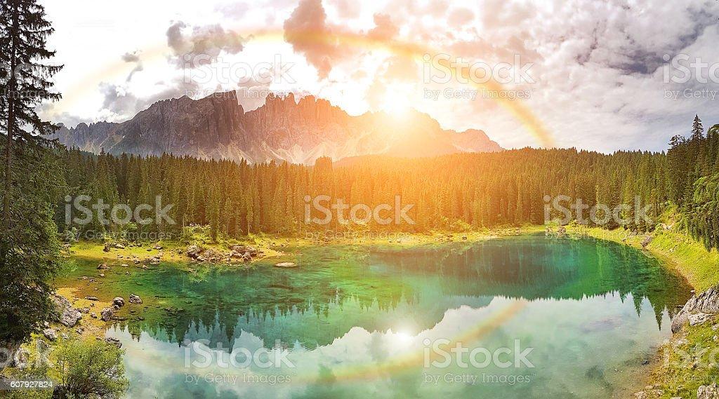 Rainbow on Carezza Lake  - Trentino Alto Adige - Italy stock photo