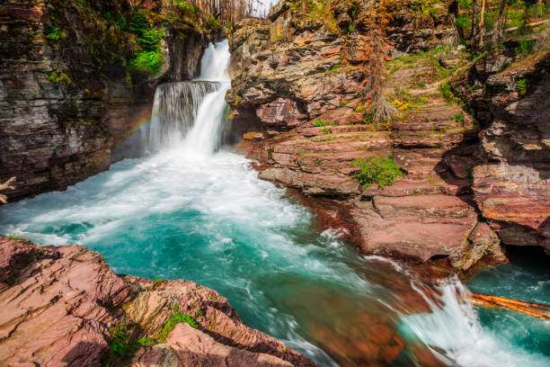 rainbow on saint mary falls, glacier national park - st. mary lake stock pictures, royalty-free photos & images