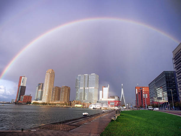 Rainbow on the city of Rotterdam stock photo