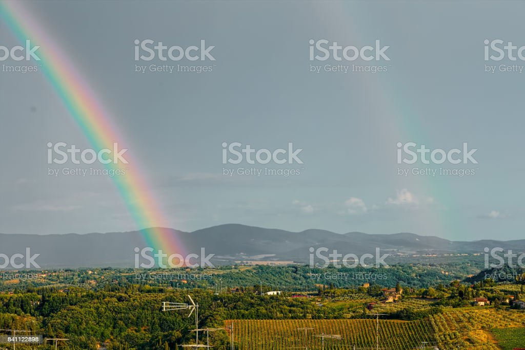 Rainbow on the medieval village of San Gimignano, Tuscany stock photo