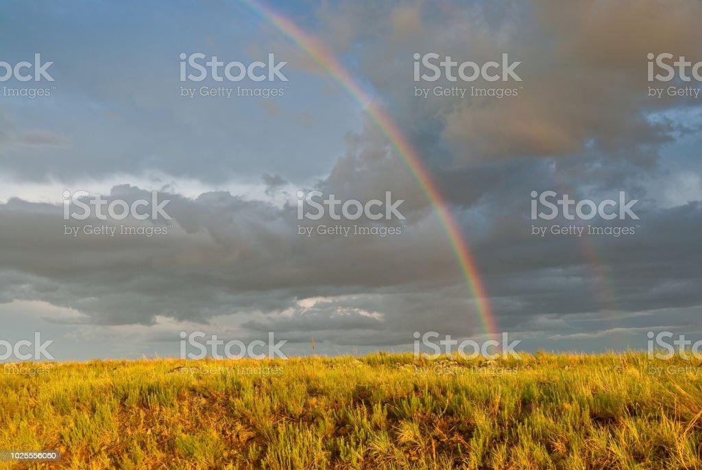 Rainbow Over a Meadow stock photo