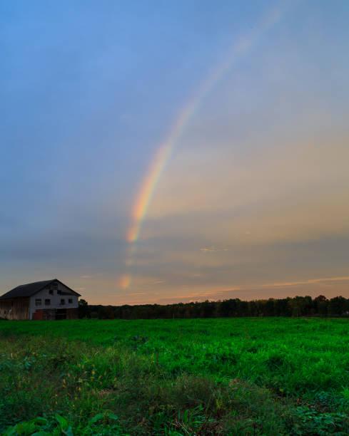 Rainbow over autumn hillside in Berkshires Hudson Valley NY stock photo