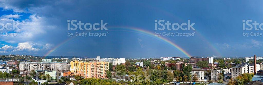 Rainbow over city royalty-free stock photo