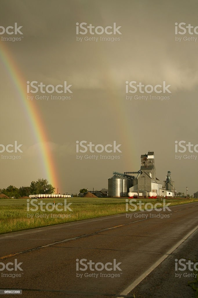 Rainbow over country elevator royalty-free stock photo
