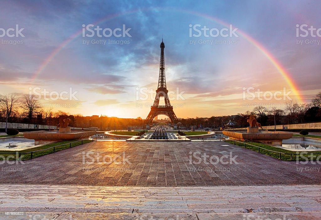 Rainbow over Eiffel tower, Paris stock photo