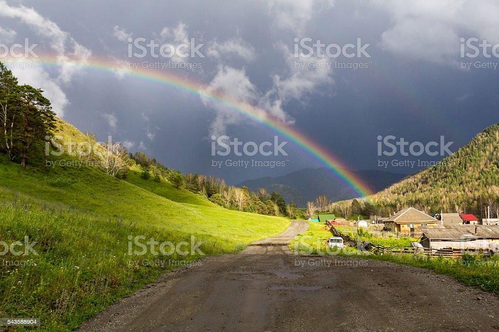 Rainbow over hills stock photo