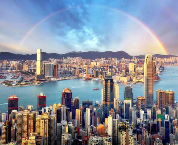 Rainbow over Hong Kong city skyline stock photo