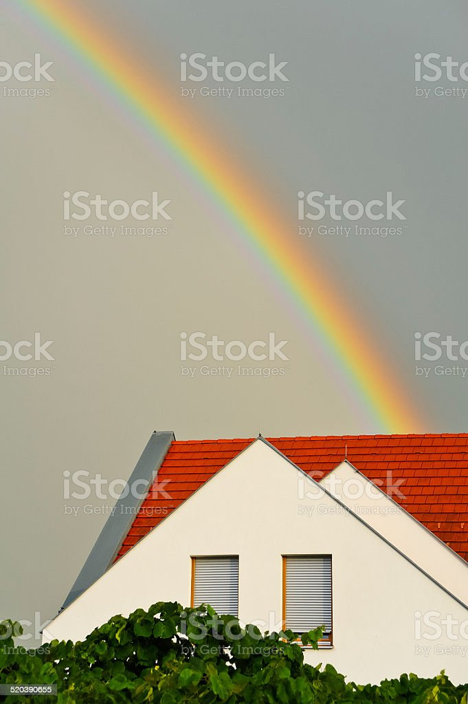Rainbow over house stock photo