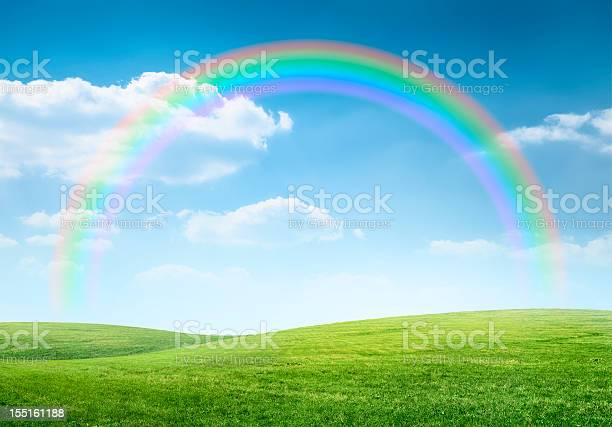 Photo of Rainbow over idyllic hilly landscape