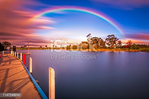Boat ramp at Johnsonville in East Gippsland at dusk with rainbow