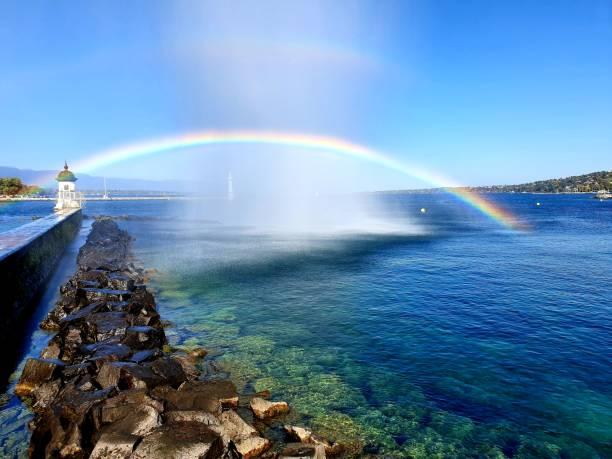 Rainbow over lake stock photo