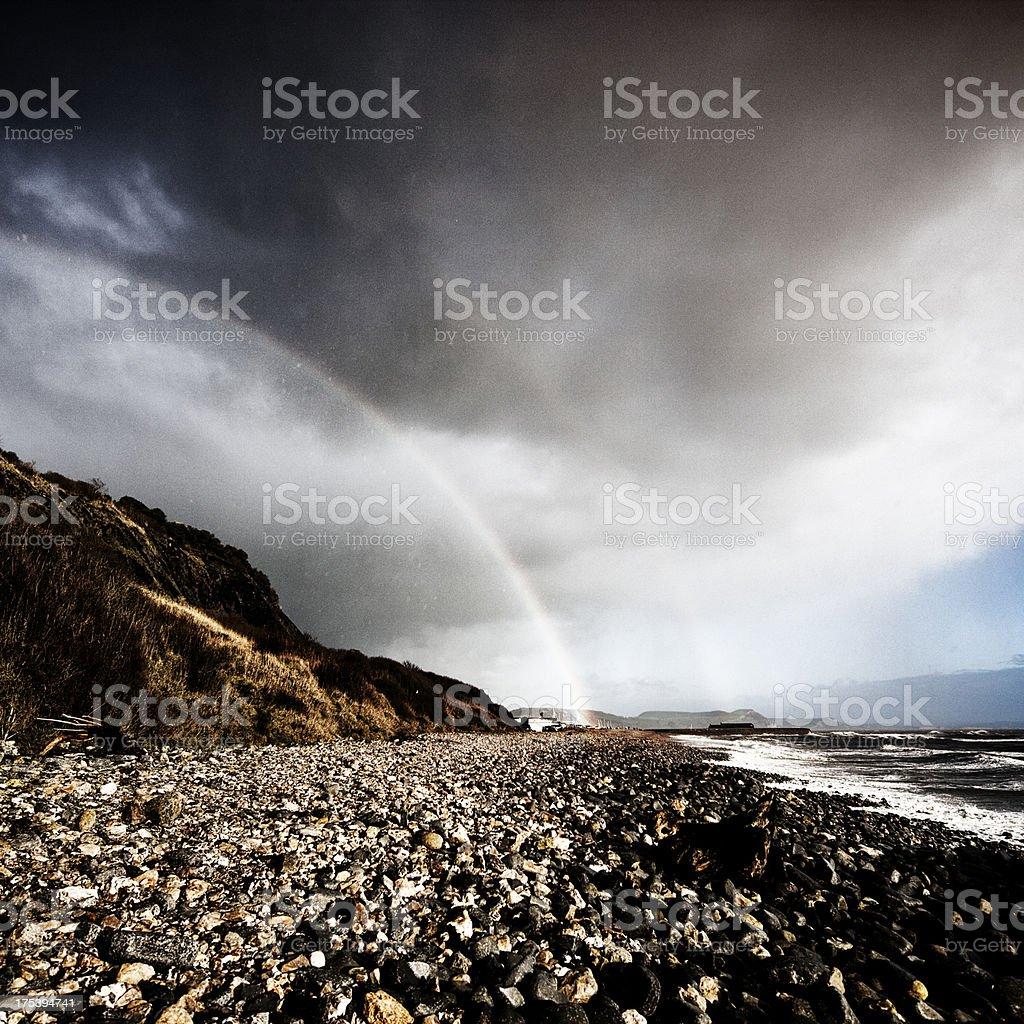Rainbow over Lyme Regis stock photo