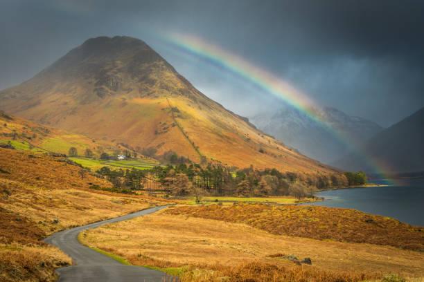 Rainbow over mountain peaks Wast Water Yewbarrow Lake District UK stock photo