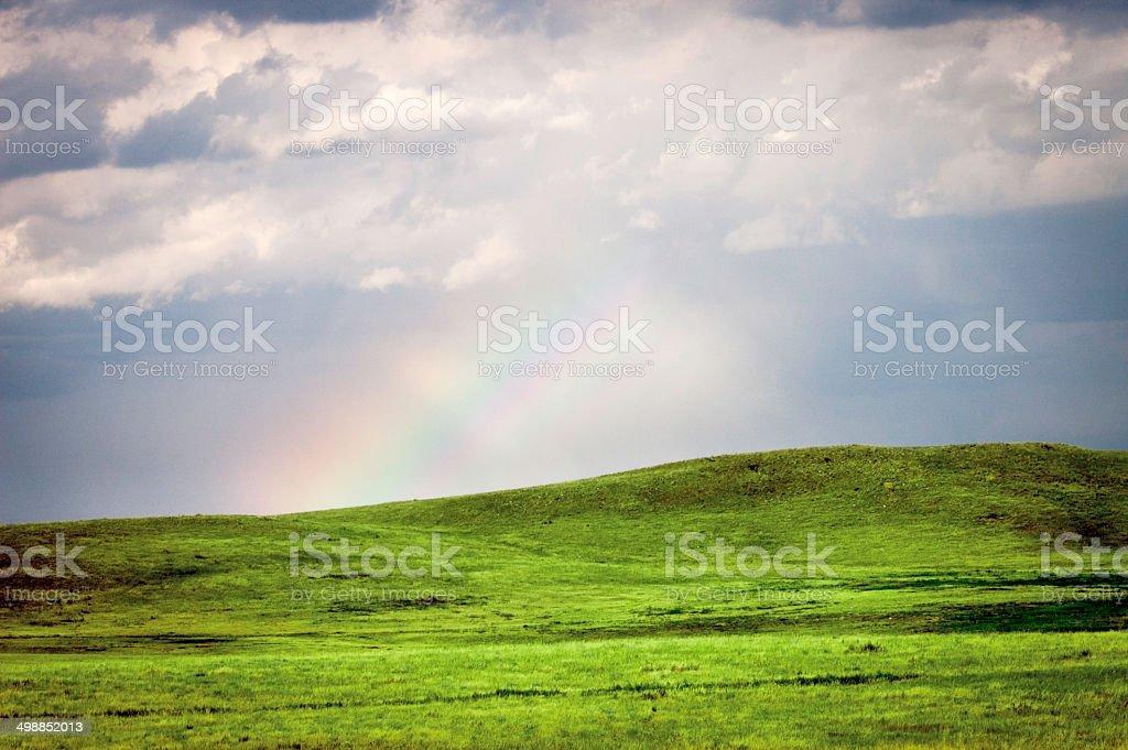 Rainbow over plains in South Dakota stock photo