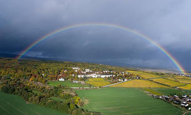 rainbow over rheingau - aerial view - wettervorhersage deutschland stock-fotos und bilder