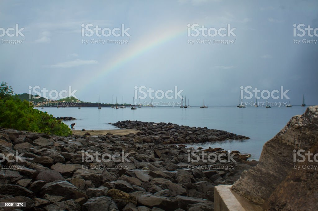 Rainbow over Sailboats stock photo