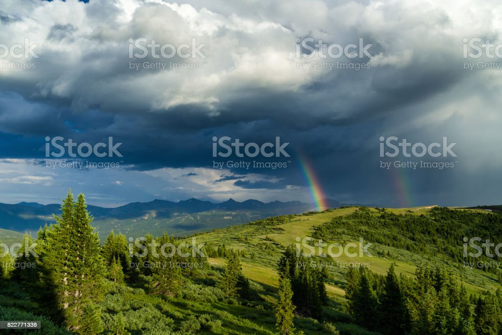 Rainbow Over Scenic Mountain Landscape stock photo