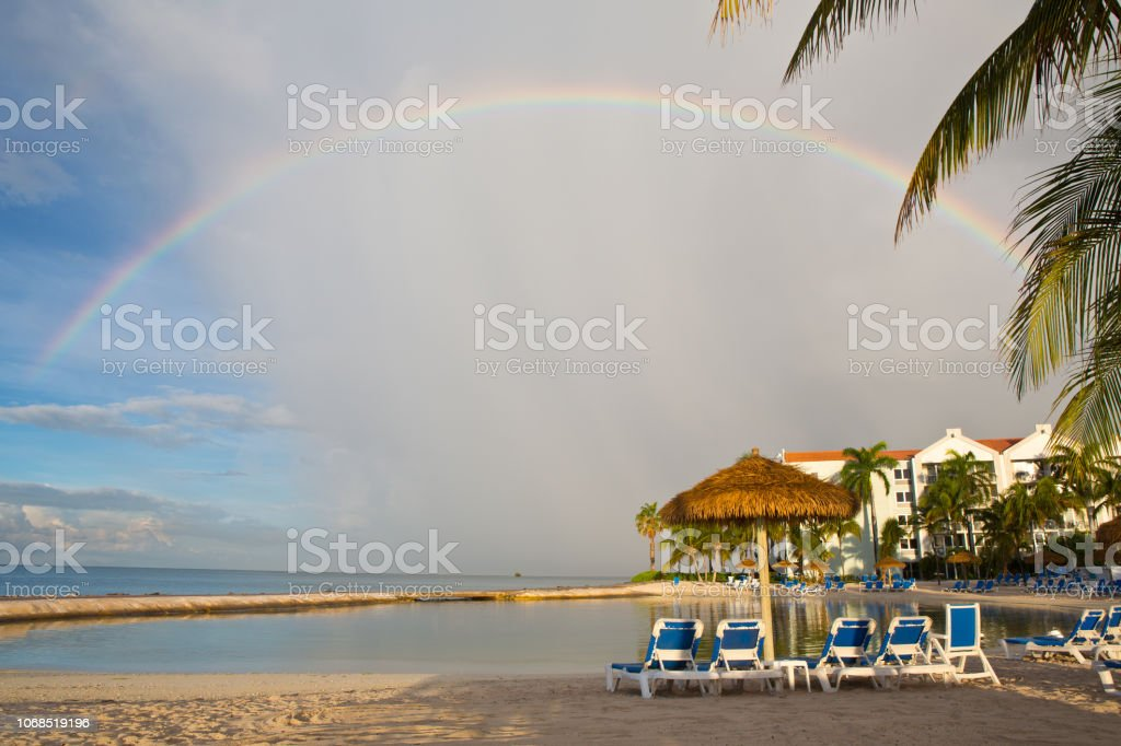 Rainbow over shoreline in Oranjestad Aruba stock photo