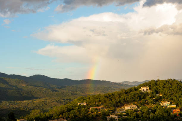 Rainbow Over Sunny Wooded Hills Landscape