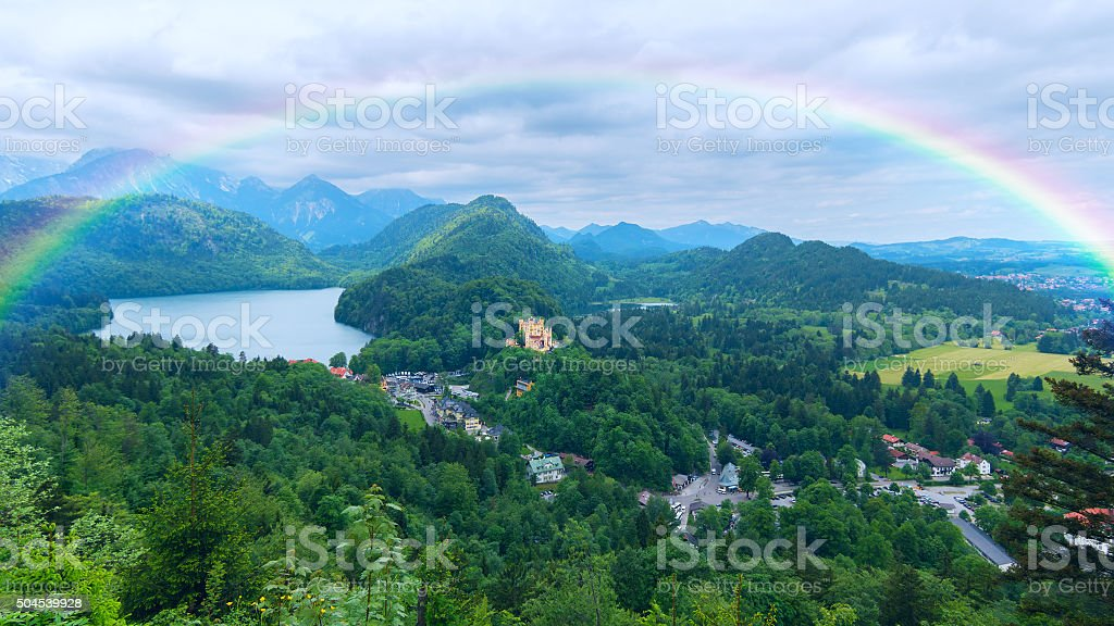Rainbow over the castle in Bavaria stock photo