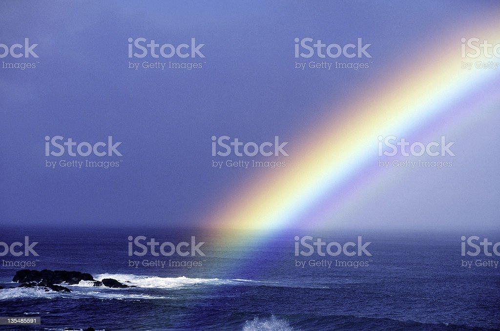 Rainbow over the pacific ocean near Oahu Hawaii USA stock photo