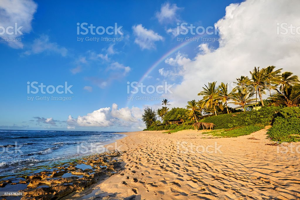 rainbow over the popular surfing place Sunset Beach, Oahu, Hawaii stock photo