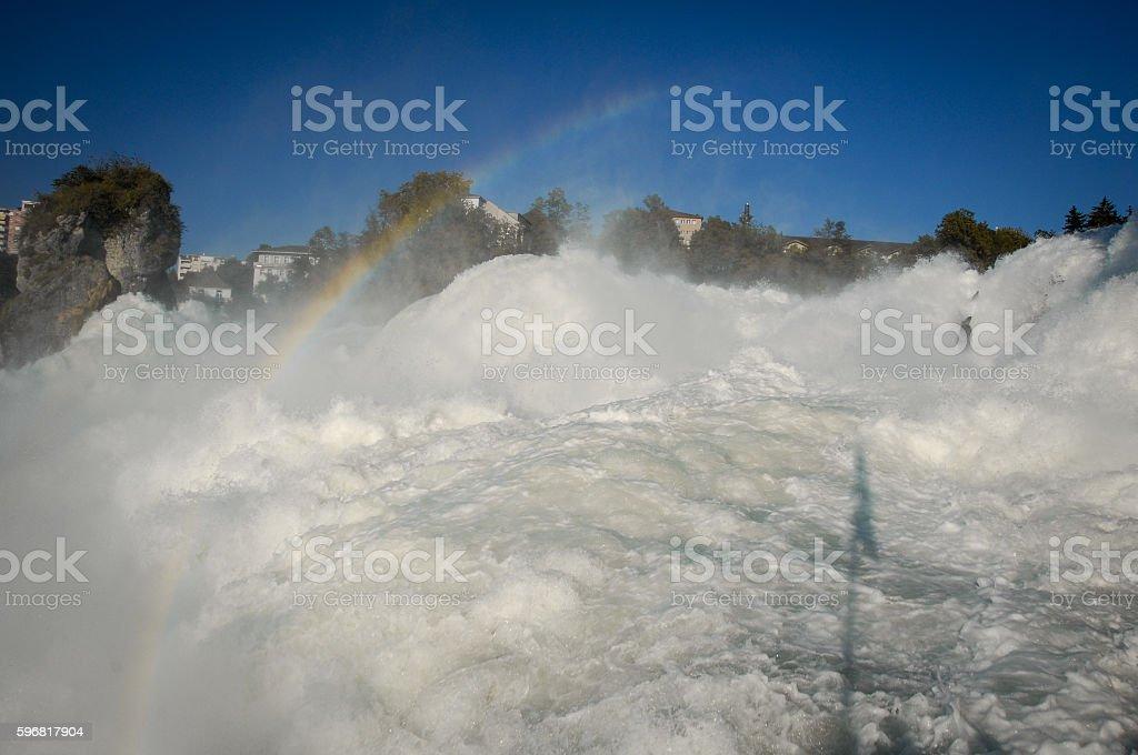 rainbow over the Rhine Falls stock photo