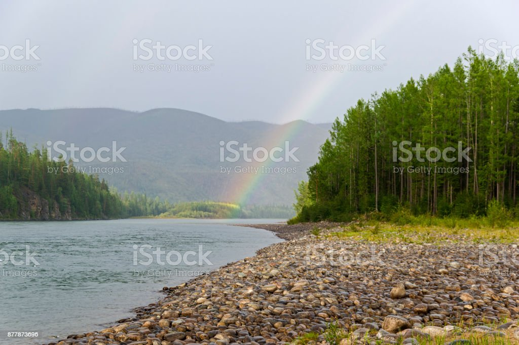 Rainbow over the river. stock photo
