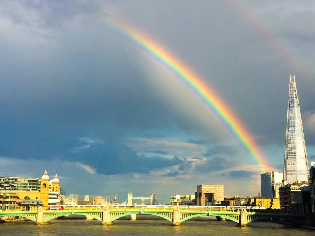 Rainbow over the river Thames in London stock photo