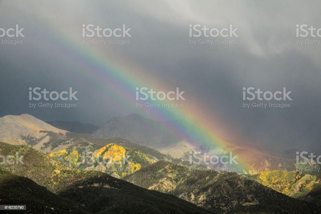 Rainbow over the Sangre de Cristo Mountains stock photo