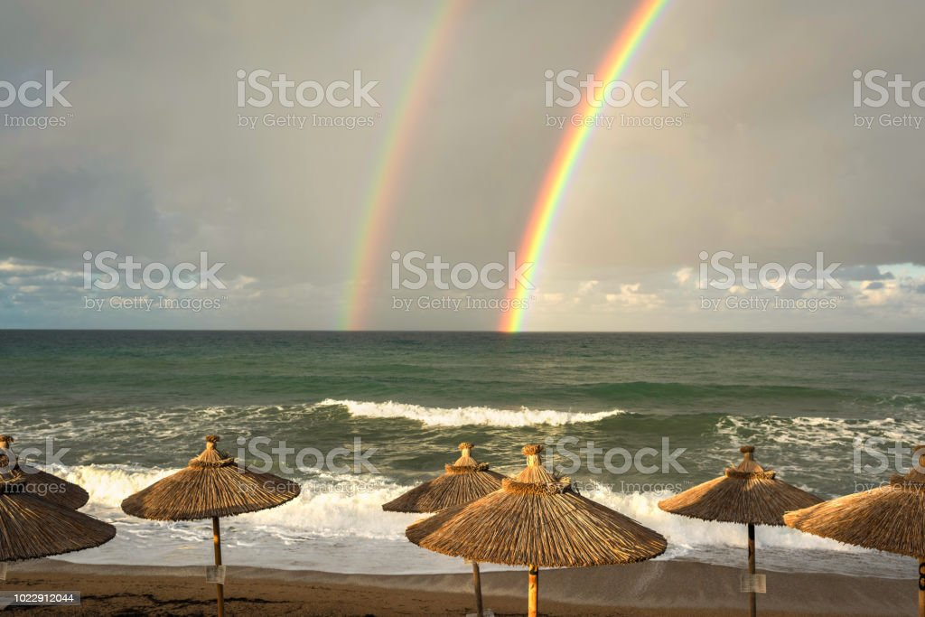 Rainbow Over The Sea And Tropical Beach With Umbrellas Chairs And Tables  Top View Stock Photo - Download Image Now
