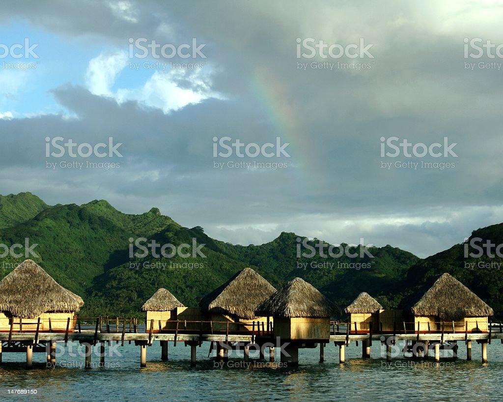 Rainbow over the Tahaa Bungalows stock photo